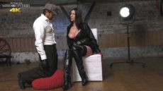 Miss Hybrid on the job training, leather boots, stockings and huge tits.
