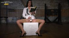 Miss Hybrid stockings and high heels playing with her magic wand in the dungeon.